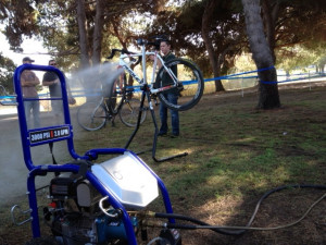 Andrew cleaning bikes with Yamaha power washer.